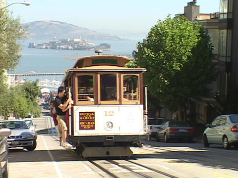 A trolley drives up a street in San Francisco Footage
