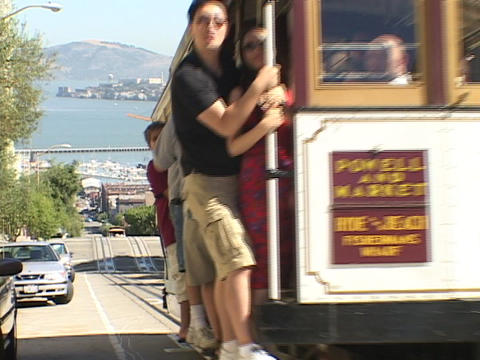 A trolley drives up a street in San Francisco Stock Video Footage