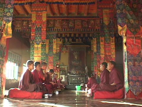 Teen Buddhist monks talk in a monastery Stock Video Footage