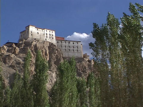 A monastery adorns a cliff top in Ladakh Stock Video Footage