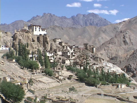 A monastery nestles in the Himalayan mountains Stock Video Footage