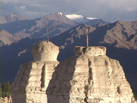 Buddhist stupas sit in the shadow of the Himalayas Footage
