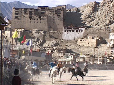 Men play polo in front of a palace in the Himalayas Footage