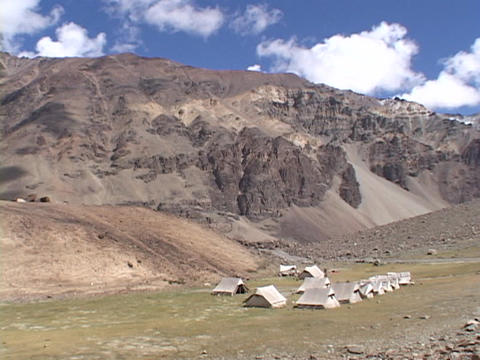 A campsite sits in a remote mountain range Stock Video Footage