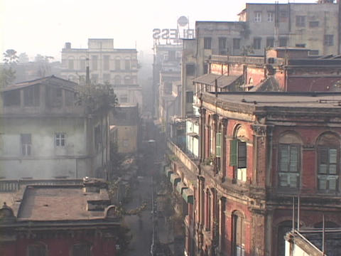 Smoke rises from a building in Calcutta, India Stock Video Footage