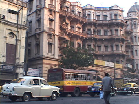 Traffic drives on a busy street in Calcutta, India Footage