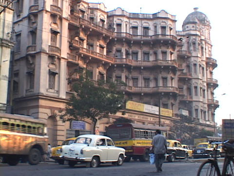 Traffic drives on a busy street in Calcutta, India Stock Video Footage