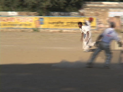 Indian men play a game of cricket Stock Video Footage