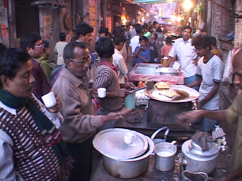 People buy food from vendors in an open air market in... Stock Video Footage