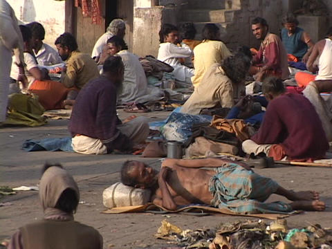 Poor people lay out on the ground in India Stock Video Footage