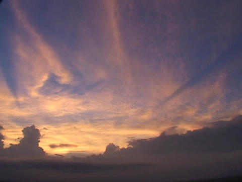 Orange clouds drift across the sky Stock Video Footage