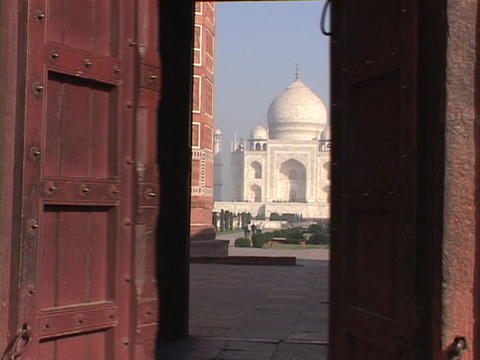 A wooden door opens to reveal the Taj Mahal Stock Video Footage