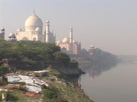 People wash clothes in the Yamuna River Stock Video Footage
