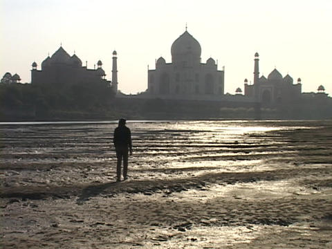 A man walks toward the Taj Mahal Stock Video Footage