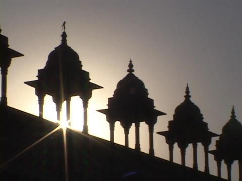 The sun's rays shine past a row of Mogul domes Stock Video Footage