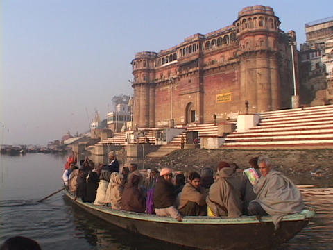 Hindu pilgrims sing and clap in a boat Stock Video Footage