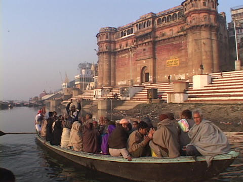 Hindu pilgrims sing and clap in a boat Footage