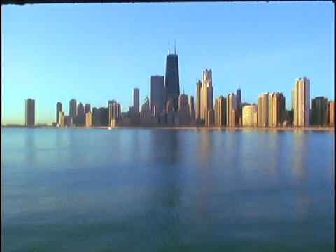 The Chicago skyline rises above Lake Michigan Stock Video Footage