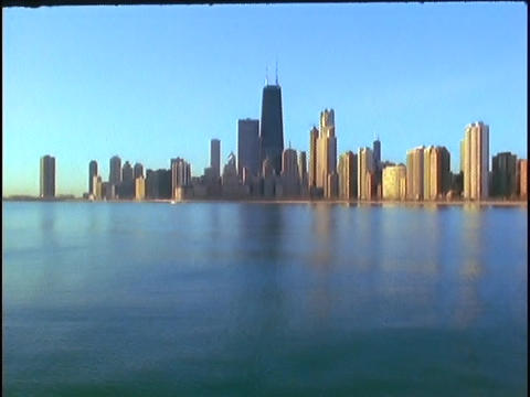 The Chicago skyline rises above Lake Michigan Footage