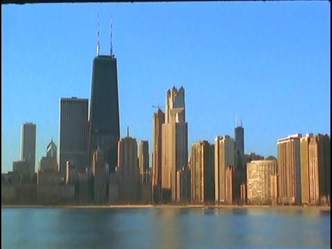 Chicago, Illinois rises above Lake Michigan Stock Video Footage