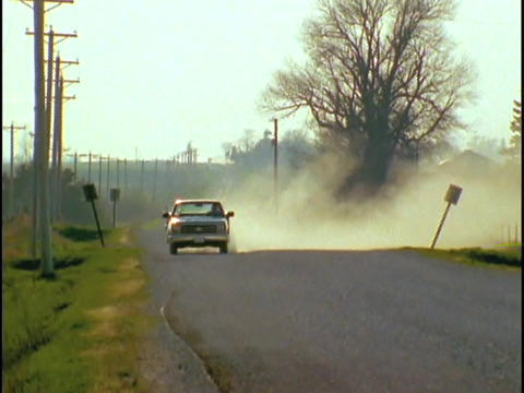 A pickup truck drives down a dirt road Stock Video Footage