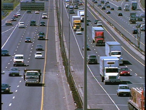 Heavy traffic drives on a freeway Stock Video Footage