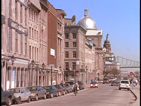 Traffic moves along a waterfront street in Montreal Stock Video Footage