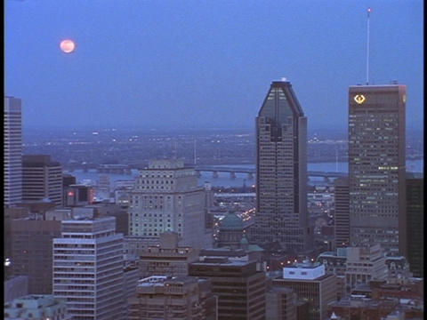 A bridge spans a river behind the Montreal skyline Stock Video Footage