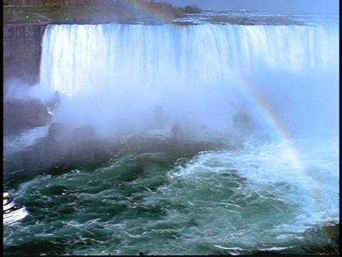 A Maid of the Mist tour boats approaches the mist of... Stock Video Footage