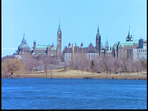 A river flows in front of the Ottawa skyline Footage