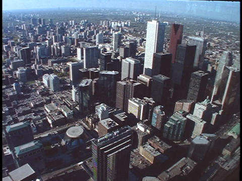 The CN Tower and a variety of skyscrapers tower above the city of Toronto Footage