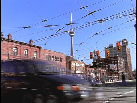 Cars and trolleys cross an intersection in Toronto Stock Video Footage
