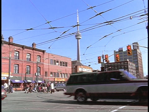 Cars and trolleys cross an intersection in Toronto Footage