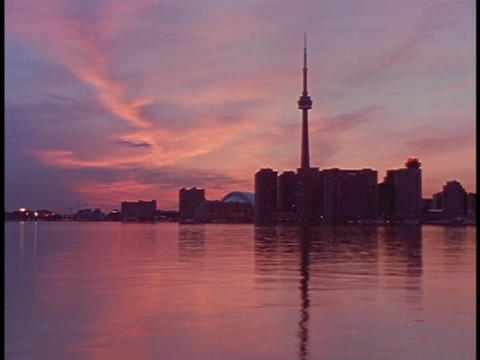 A low sun tints the sky in Canada pink Footage