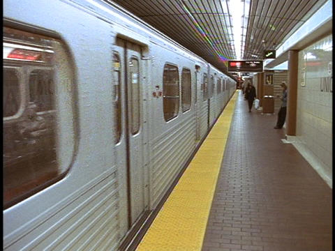A subway train arrives at a train station Footage