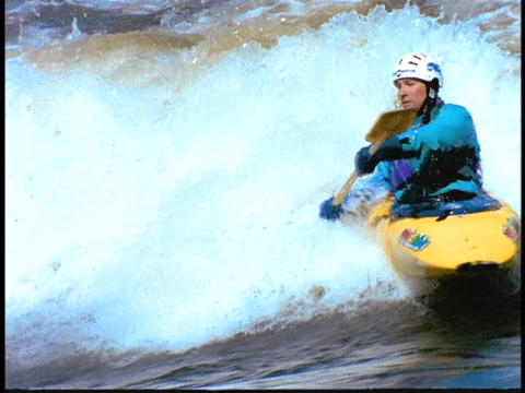 A man moves through rapids in a kayak Stock Video Footage
