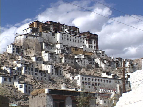 A monastery rests on a hill in Tibet Live Action