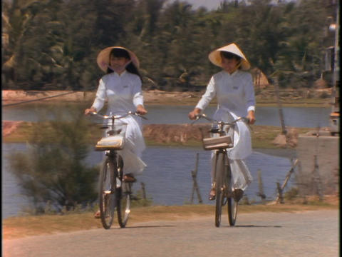 Vietnamese students ride bicycles Stock Video Footage