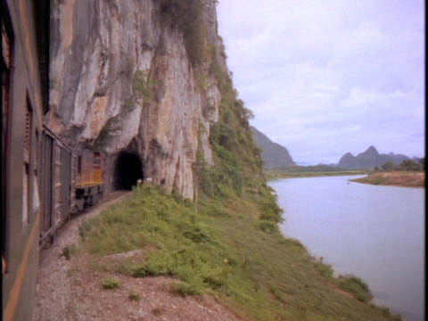 A train goes into a tunnel Stock Video Footage