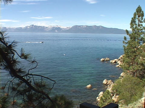 A speed boat races across scenic Lake Tahoe Stock Video Footage