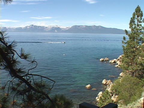 A speed boat races across scenic Lake Tahoe Footage