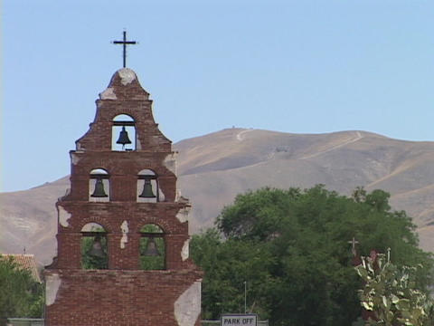 Bells fill a tower at an old Catholic mission Stock Video Footage