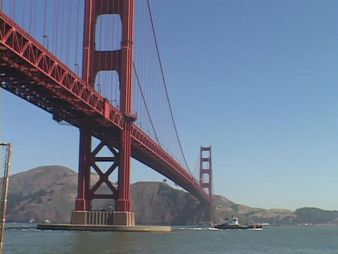 A boat travels under the Golden Gate Bridge Stock Video Footage