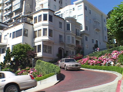 Cars carefully drive on Lombard Street in San Francisco, California Footage