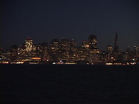 San Francisco lights glow across a bay Footage