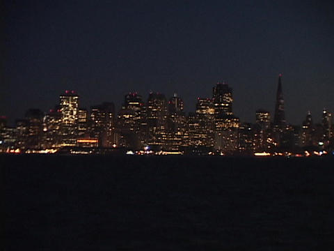 San Francisco lights glow across a bay Stock Video Footage