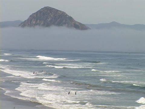 Waves crash on the beach at Morro Bay, California Stock Video Footage