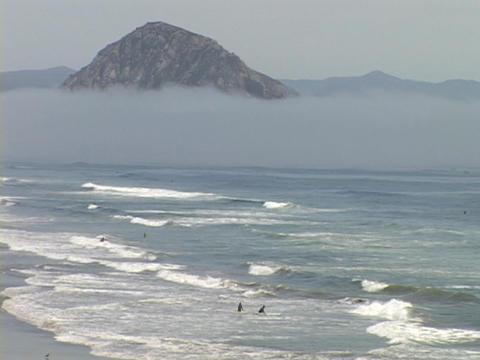 Waves crash on the beach at Morro Bay, California Live Action