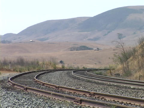 The Amtrak passenger train travels along a track Stock Video Footage