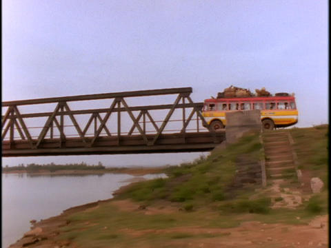 An old bus crosses a bridge which used to be the border... Stock Video Footage